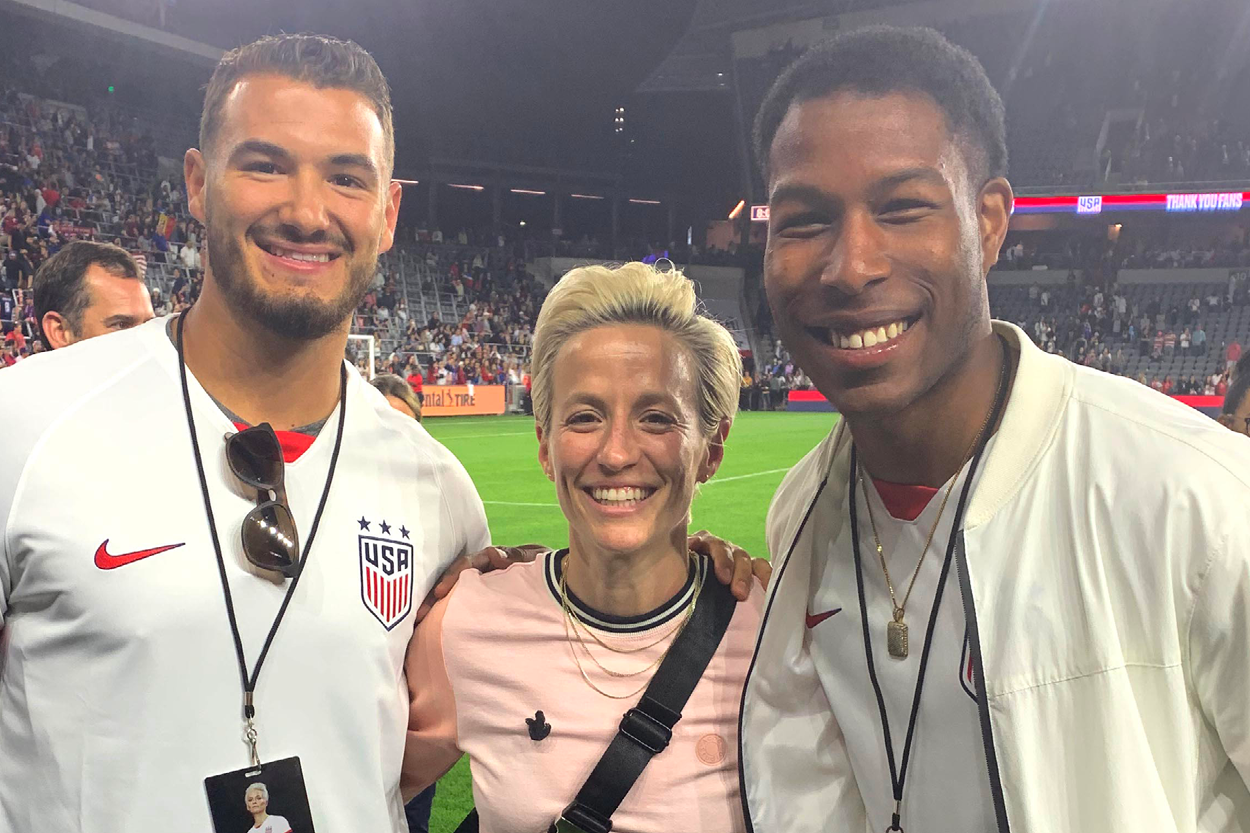 Mitch Trubisky, Megan Rapinoe and Jordan Fieulleteau '16, '18 (M.A.) pictured at a women's soccer match in Los Angeles in April 2019.
